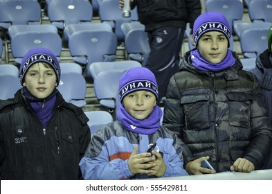 ODESSA, UKRAINE - December 08, 2016: Active fans with attributes of Manchester United support team in the stands during the UEFA Europa League match between Zarya vs Manchester United, Ukraine