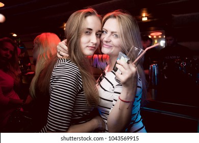 Odessa, Ukraine December 1, 2016: Palladium night club. Women smiling and posing on cam during concert in night club party. Girl have fun at club. girl at night club party