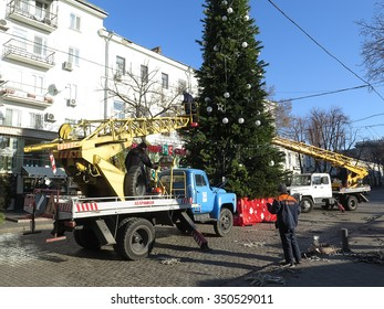 Odessa, Ukraine, December 12 2015: X'mas preparations - decorating the christmas tree on the Deribasovskaya Str. in Odessa city, using boom lifts (II)
