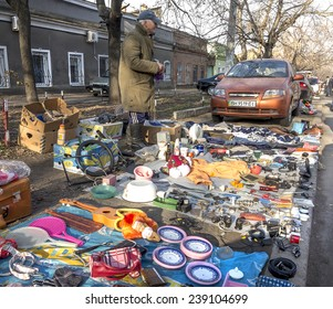 Odessa, Ukraine - December 20, 2014: People visit the authentic famous flea market Starokon Bazaar, which sells any antiques and home objects, December 20, 2014 in Odessa, Ukraine.