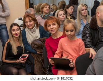 Odessa, Ukraine - December 22, 2016: Audience in theater at children's concert. Parents with children in children's theater hall emotionally watching the performance of their young children in school