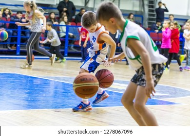 Odessa, Ukraine - December 23, 2018: young children play basketball, participate in children's sports competitions during celebration of children's sports basketball club of children's sports school
