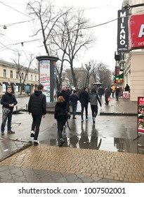Odessa, Ukraine - December 28, 2017: People visit Deribasovskaya Street. Deribasovskaya is the central street of Odessa and one of the main attractions of the city.