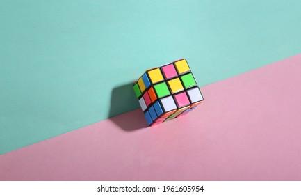 Odessa, Ukraine - December 29, 2020: Rubik's cube on blue pink pastel background