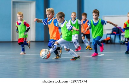 Odessa, Ukraine - December 3, 2016: Little boys, children play in mini-football in indoor sports hall at Junior championship sports city. Children sports - healthy lifestyle. Sport boy footballers