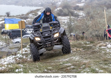 Odessa, Ukraine - December 6, 2014: Off-road vehicle on a motocross track on the road passes in winter mountains, December 6, 2014 in Odessa, Ukraine.