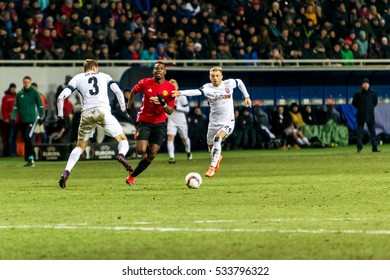 Odessa, Ukraine - December 8, 2016: Football game of  Europa League. FC Zorya Lugansk and FC Manchester United. 0: 2. Tense active fight for ball. Manchester United player Paul Pogba 6