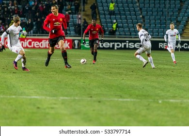Odessa, Ukraine - December 8, 2016: Football game of  Europa League. FC Zorya Lugansk and FC Manchester United. 0: 2. Tense active fight for ball.Manchester United player 9 Zlatan Ibrahimovic