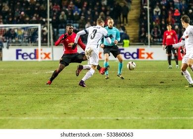 Odessa, Ukraine - December 8, 2016: Football game of  Europa League. FC Zorya Lugansk and FC Manchester United. 0: 2. Tense active fight for ball.