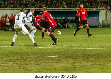 Odessa, Ukraine - December 8, 2016: Football game of Europa League. FC Zarya Lugansk and FC Manchester United. 0: 2. Tense active fight for ball.