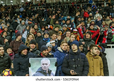 Odessa, Ukraine - December 8, 2016: head coach, manager of Manchester United Jose Mourinho talks to audience in stadium before game Manchester United. Selfies with Mourinho at stadium. Football fans