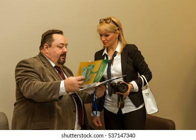 """Odessa, Ukraine - December 8, 2016 Business Conference """"Business Strategy 2016"""". Business people in conference room listening to report of  coach, teacher on grants. Accreditation Center, reception"""