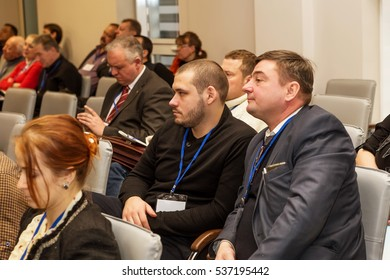 """Odessa, Ukraine - December 8, 2016 Business Conference """"Business Strategy 2016"""". Business people in conference room listening to report of business coach, teacher on grants"""
