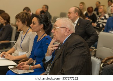 "Odessa, Ukraine - December 8, 2016 Business Conference ""Business Strategy 2016"". Business people in conference room listening to report of business coach, teacher on grants"