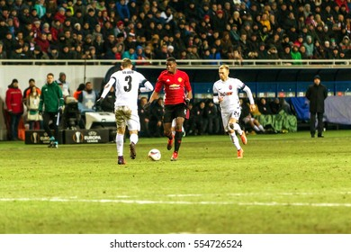 Odessa, Ukraine - December 8, 2016: Football game of the Europa League. FC Zorya Lugansk FC and Manchester United. 0: 2. Tense active fight for the ball.