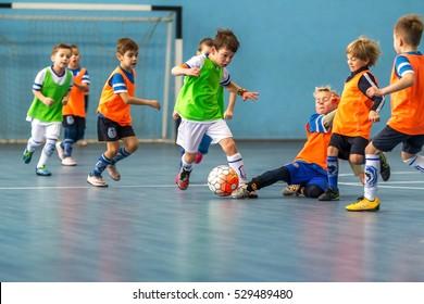 Odessa, Ukraine -December3,2016: Little boys, children play in mini-football in indoor sports hall at Junior championship sports city. Children's sports - healthy lifestyle. Sport children footballers