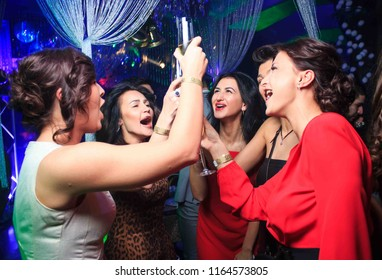Odessa, Ukraine Desember 31, 2015: Opera night club. Women smiling and posing on cam during concert in night club party. Girl have fun at club. girl at night club party
