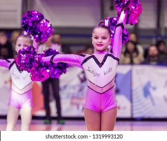 Odessa, Ukraine - Febr 16, 2019: Bright dynamic characteristics of a support group of women's sports team. Performance Support Group. Bright beautiful young girl in sports dance form on the playground
