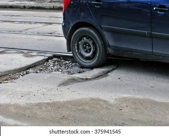 Odessa, Ukraine, February 12, 2016 -: Large deep pothole in the city centre an example of poor road maintenance due to reducing local council repair budgets