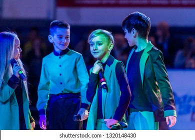 Odessa, Ukraine - February 16, 2019: Children's music groups singing and dancing on basketball court during a commercial break. Children's play. Emotional children's show on stage. Dancing on stage
