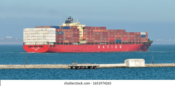 Odessa / Ukraine - February 17 2020: Transportation of ZIM sea containers. Container ship NAVIOS SUMMER IMO 9308003 managed by ZIM sea container operator leaves port of Odessa for Bosphorus