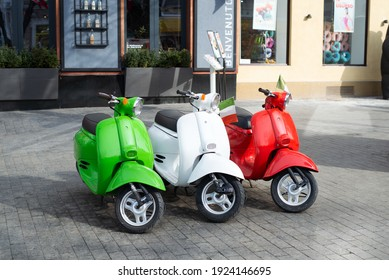 Odessa, Ukraine. February 2021. Italian style. Retro scooters in the colors of the flag of Italy at the entrance to the restaurant. Exposition and traditions