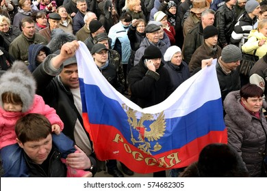 ODESSA, UKRAINE - February 23, 2014: People demonstrating civil peaceful protest during a state of armed revolution Ukraine. Movement of column of demonstrators at rally on the streets