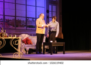 "ODESSA, UKRAINE - FEBRUARY 26, 2016: Actors of theater play role of secret lovers in performance of comedy ""Child for hire"". Actors on  theater stage during comedy. Performance on theater stage"