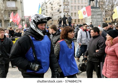 ODESSA, UKRAINE -February23, 2014: People on policy it has been demonstrated civil peaceful protest during state of armed revolution in Ukraine. Movement of column of demonstrators at rally on streets