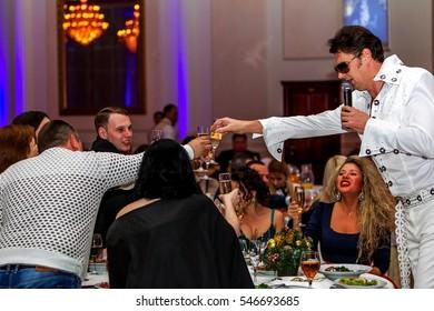"ODESSA, UKRAINE - January 1, 2017: Elvis Presley Simulator performs at concert in restaurant. Elvis Presley, King of Pop. Speech ""Viva Elvis Surfers Paradise"" at concert in nightclub"