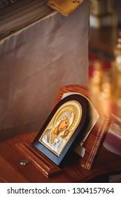 ODESSA, UKRAINE - JANUARY 18, 2015: Ukrainian Orthodox Christian Church of Saint Mary Magdalene, golden icon of the Mother of God, the Virgin Mary. Details in the orthodox christian church