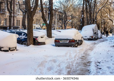 Odessa, Ukraine - January 19, 2016: A powerful cyclone, a blizzard, heavy snow paralyzed the city. Kolaps. Snow Europe. Winter problems with the car. Snowed. Road Closed. Stopped traffic