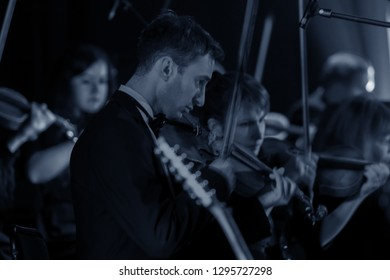ODESSA, UKRAINE - JANUARY 24, 2019: Symphony orchestra concert on theater stage. Musicians of State Symphony Orchestra, instruments of symphony orchestra on stage. Score, sheet music during concert