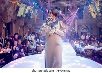 Odessa, Ukraine January 7, 2017: Famous Ukranian Artist Gaitana performs songs from stage during concert at nightclub. Artist on club stage during night party