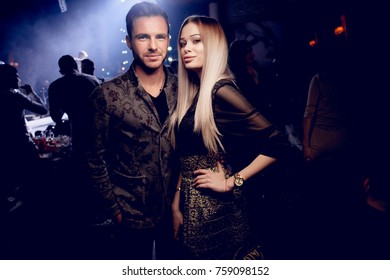 Odessa, Ukraine January 7, 2017: People smiling and posing on cam during concert in night club party. Man and woman have fun at club. Boy and girl at night club party
