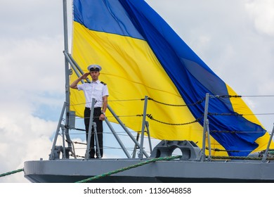 ODESSA, UKRAINE - Jul 16, 2018: Multinational maritime exercise Sea Breeze 2018, in which military personnel of NATO and partner countries takes part. Sailor of the Navy against the flag of Ukraine