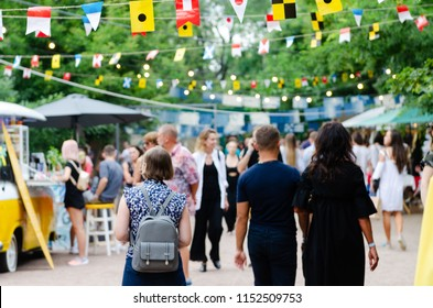 Odessa, Ukraine - July 07, 2018: Food Festival in Odessa, Ukraine. A lot of people attend an annual event dedicated to street food from suppliers and local restaurants. Blurred on Purpose.