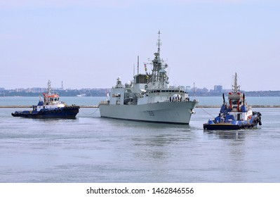 Odessa / Ukraine - July 09 2019: Docking tugboats P&O STAR and P&O BALQIS tow the participant of Sea Breeze 2019 exercises in  Black Sea Canadian Navy frigate HMCS TORONTO in Odessa harbour