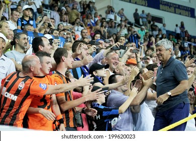 ODESSA, UKRAINE - July 10, 2013: Mr. Mircea Lucescu and emotional football fans during the game Shakhtar Donetsk and Chernomorets, July 10, 2013, Odessa, Ukraine