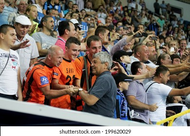 ODESSA, UKRAINE - July 10, 2013: Mr. Mircea Lucescu and emotional football fans during the game Shakhtar Donetsk and Chernomorets, July 10, 2013, Odessa, Ukraine