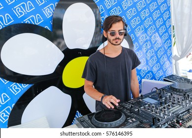 Odessa, Ukraine July 11, 2015: dj playing good music at summer pool party. Day lounge party at luxury summer club. Ibiza dj at work