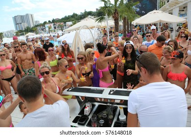 Odessa, Ukraine July 11, 2015: Large number of spectators at beach party dancing and having fun at dance music. Spectators show during beach party under scorching sun in exclusive beach club