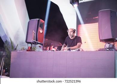 Odessa, Ukraine July 11, 2015: Ibiza club Dj at work in luxury nightclub during night party. Dj make party time at elite night club.