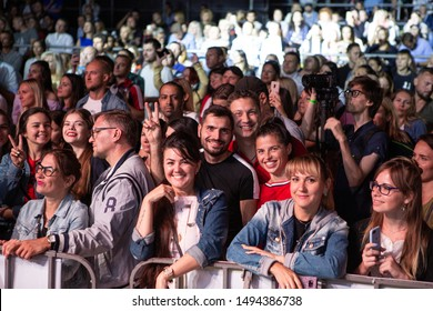 Odessa, Ukraine July 11, 2019: Many spectators at concert. crowd of visitors to concert has fun and shoots what is happening on smartphones. Fans at concert idol. Audience at consert