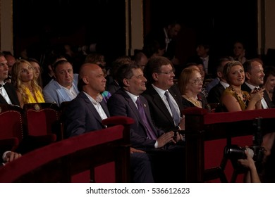 ODESSA, UKRAINE - July 12, 2015: Spectators at a concert during the creative light and music show trendy jazz orchestra. Satisfied with the fans in the hall. Toning, selective focus