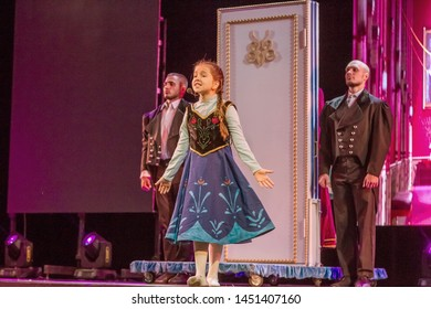 """ODESSA, UKRAINE - July 14, 2019: Group of actors in action on stage of Odessa Opera and Ballet Theater during performance of children's musical performance """"The Cold Heart"""". Performance for children"""