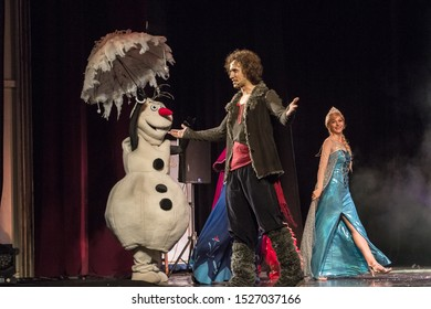 "ODESSA, UKRAINE - July 14, 2019: Group of actors in action on stage of Odessa Opera and Ballet Theater during performance of children's musical performance ""The Cold Heart"". Performance for children"