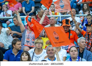 ODESSA, UKRAINE - July 15, 2017: FOXTROT Super Cup. Fanatical fans in stands during game of eternal rivals. Fans in stands rejoice, shout and fluttering flag. People are looking at stadium