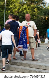 ODESSA, UKRAINE - July 15, 2017: Trade in football symbols, football souvenirs are sold before the game. Football Scarves teams Shakhtar and Dynamo buy fans and fans of teams