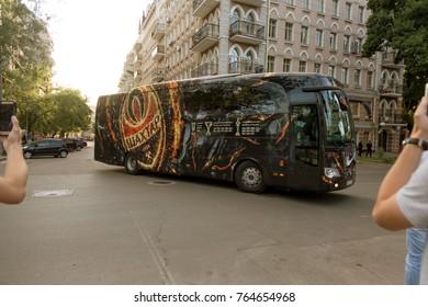 ODESSA, UKRAINE - July 15, 2017: Branded company bus of Shakhtar football club moves to stadium. Enthusiastic fans photograph branded club bus Shakhtar - Donetsk. Football symbols